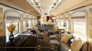 Light train bar car with arched windows, baby grand piano and lavender lamp shades