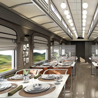 Light and contemporary train dining car lined with arched picture windows