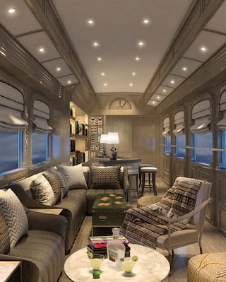 Cosy lamplit train observation car with sage and grey soft furnishings