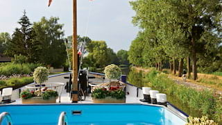 View of idyllic rural France from a plunge pool on the top deck of a river barge