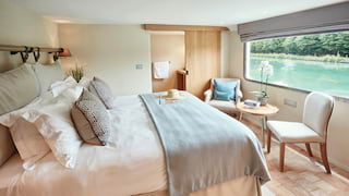 Beautiful light and airy barge cabin with a large picture window and river views