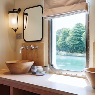 Cabin ensuite with light maple wood details and a large window with river views
