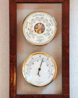 Close-up of polished brass speed and temperature gauges