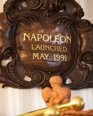 Mahogany ship's emblem with 'Napoleon launched May 1991' in gold lettering