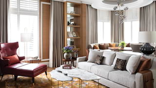 Hotel suite lounge area with parquet flooring and warm grey and tan accents