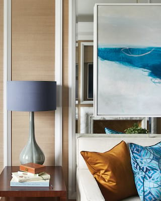 Close-up of a hotel suite side table and sofa with contemporary art work above