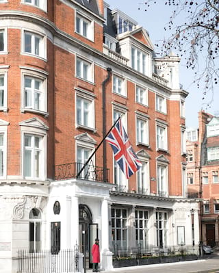 Exterior of The Cadogan with a Union Jack flying from a flagpole