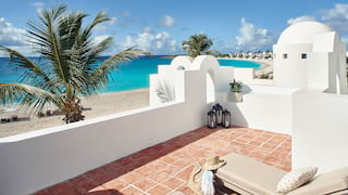 Roof terrace with sun beds overlooking an Anguilla beach