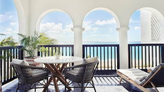 Blue-tiled terrace seating area with views of the Caribbean sea beyond