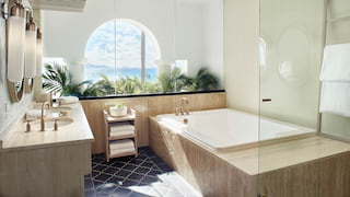 Large square bath in a bathroom with Caribbean Sea views