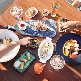 Birds-eye view of table laden with seafood dishes