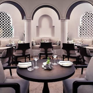 Circular restaurant room with dark wooden chairs and tables