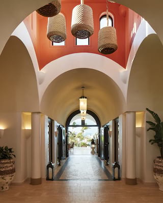 Barrel-vaulted corridor with terracotta tiled floor