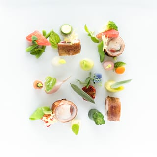 Birds-eye-view of an artistic starter dish with colourful vegetables and edible flowers