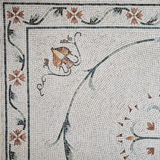 Birds-eye-view of a mosaic floor with a dainty yellow floral pattern