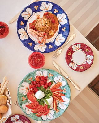 Birds-eye-view of colourful plates with Italian cuisine