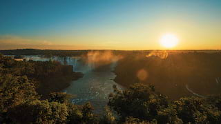 Wide-angle shot of sunrise over the Iguassu landscape and falls