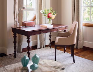 Mahogany desk at a window in an elegant hotel room