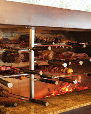 Traditional Brazilian meat barbecue over a charcoal fire