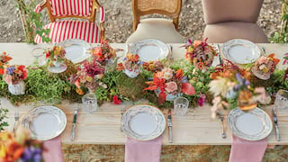 Floating table set for an outdoor banquet with a grand floral centrepiece