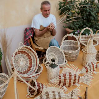 Traditional Tuscan wicker-crafted fish ornaments and baskets in a wicker shop