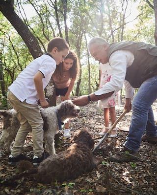 Children on truffle hunt in Tuscany