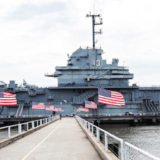 Flag-lined path leading to the exterior of a retired US Navy aircraft carrier