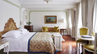 Elegant hotel room with Italian baroque detailing and polished parquet floor