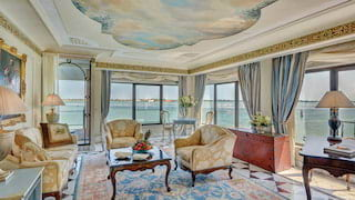 Vast hotel suite with a heavenly ceiling mural and ornate Italian baroque styling