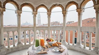 Domed open-air terrace set for a private breakfast with views across Venice