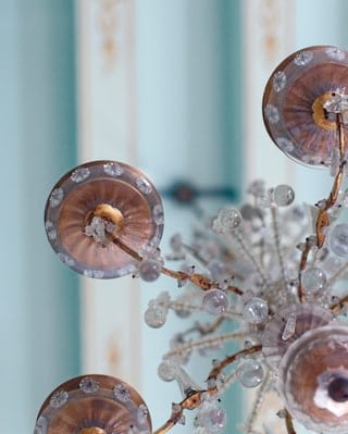 Close-up of a Murano glass chandelier against a powder blue ceiling