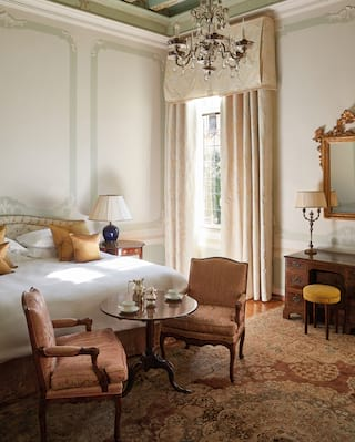 Venetian hotel suite with plush furnishings and ornate details