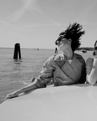 Black and white photo of a lady on a Venetian water taxi