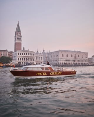 Venetian water taxi with Hotel Cipriani on the side