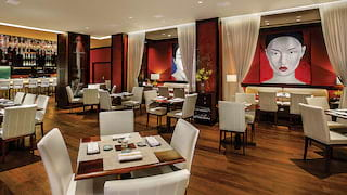 Restaurant with polished wood floor and white and red Asian-style decor