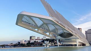 A vast, steel, avant-garde, spiky museum structure stretching over water
