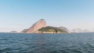 Mountains rising along the Rio de Janeiro coastline, viewed from across water
