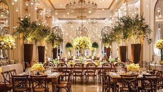 Grand ballroom with hanging candle lanterns and wedding banquet tables
