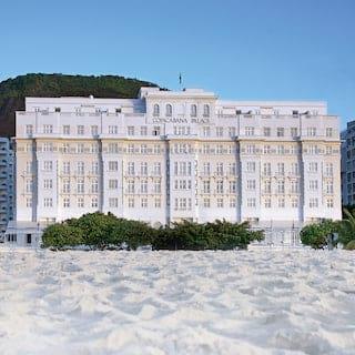 Vast art deco hotel across a powdery white beach