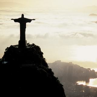 Rio's iconic 'Christ the Redeemer' statue rising into the clouds above the city