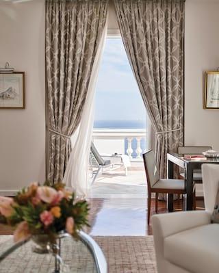 View of the Atlantic Ocean through luxurious hotel suite balcony doors