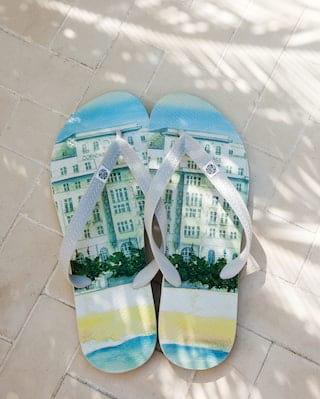 Pair of flip flops printed with an image of Belmond Copacabana Palace