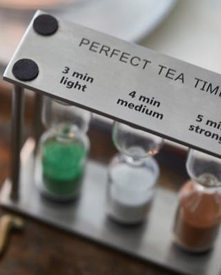 Close-up of a collection of sand timers for stewing tea