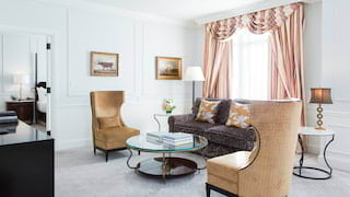 Light and airy hotel suite lounge, with luxurious furnishings and fabrics
