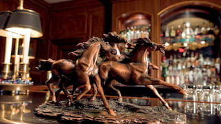Horse racing statuette placed on a marble bar top