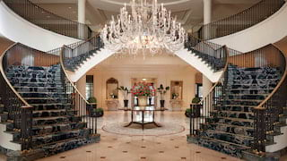 Grand circular guest lobby, with a crystal chandelier and two stairways