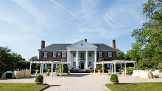 Grand plantation hall with classical-style architecture and stone drive