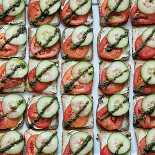 Rows of square-shaped cucumber and tomato canapes