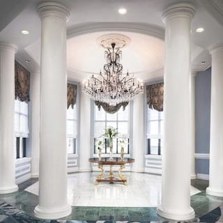 Circular open-sided indoor gazebo surrounded by white columns