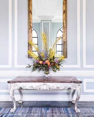 Close-up of a floral display upon a marble topped side-table